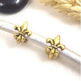 2 perles europeennes fleur de lys dorees pour cuir 5 mm