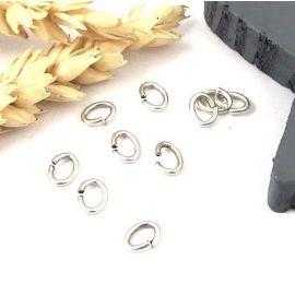 15 anneaux ovales laiton argente