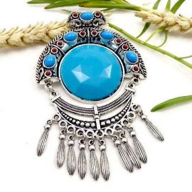 1 joli pendentif ethnique metal argent et resine turquoise 11cm