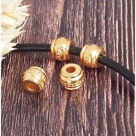 2 perles rondes zamak plaque or ethniques pour cuir rond 3mm