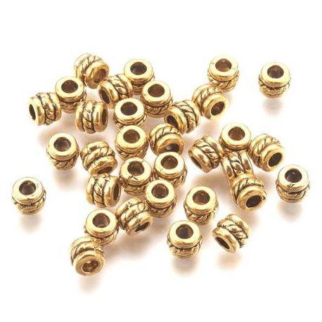 50 perles tibetaines sculptées doré vieilli pour cuir 2mm