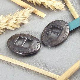 Embout fermoir ovale ethnique plaque gun metal pour cuir plat 10mm