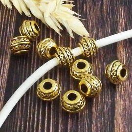 10 perles ciselees ethniques style tibetain dore antique interieur 3mm